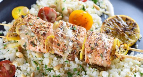 Salmon kebabs with tahini dressing